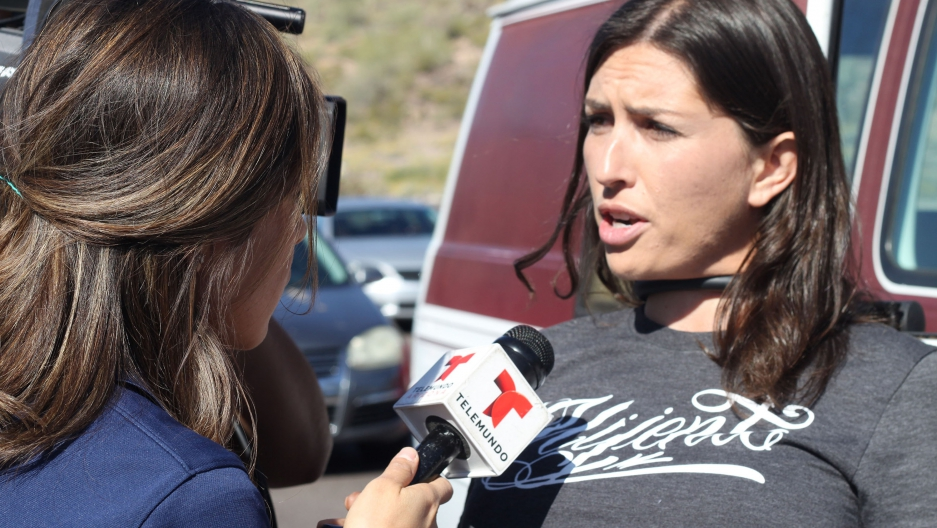 Jacinta Gonzalez locked herself to a vehicle on Mar. 19 to block the road to a Trump rally in Fountain Hills, Arizona. She was arrested with two other protestors, who were released that night. She was held detained overnight at the request of US Immigration and Customs Enforcement. Gonzalez is a US citizen. Credit: Diane Ovalle/Mijente