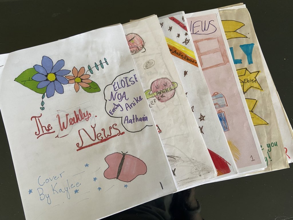 Five hand-drawn newspapers, colorful, in children's writing, laid out.